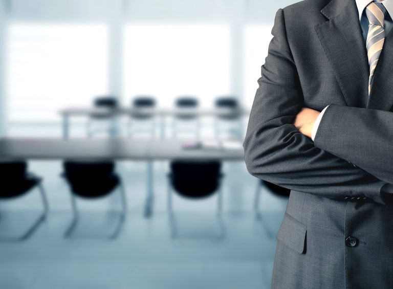 Businessman standing in a conference room